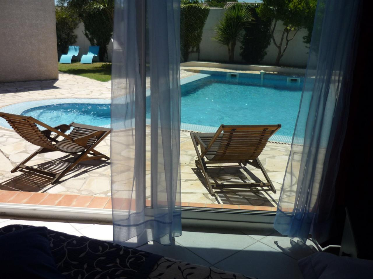 Sun loungers and pool